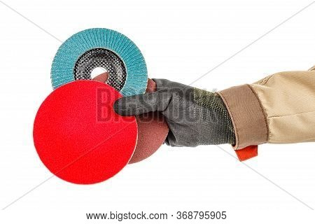 Bright Red Polishing Disc With Blue Abrasive Flap Disc And Sanding Paper Disc In Worker Hand In Blac