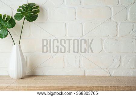 Wooden Shelf Background With Home Decor Vase.