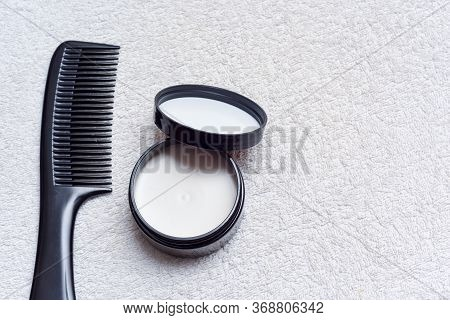 Men's Hair Product Paste With Black Comb Isolated On White Background
