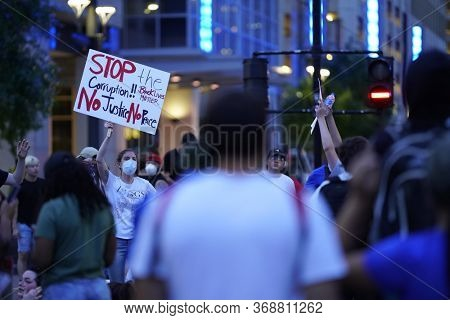 May 29, 2020 - Houston, Texas, USA: Police and spectators collide in downtown Houston, TX as rioters protest the beating and killing of George Floyd by Minneapolis police earlier in the week.