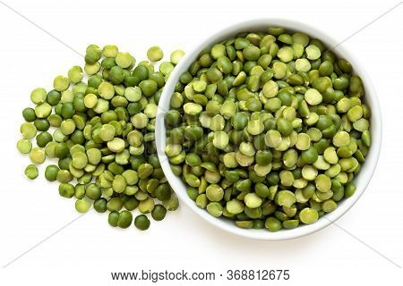 Dried Green Split Peas In A White Ceramic Bowl Next To A Pile Of Split Peas Isolated On White. Top V