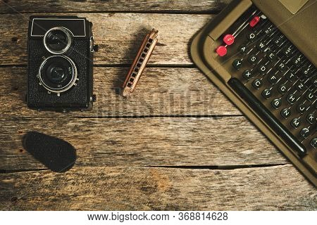 Old Retro Typewriter, Camera And Typewriter On A Wooden Background