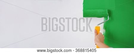 Professional Decorator Painting White Wall With Green Dye, Space For Text. Banner Design