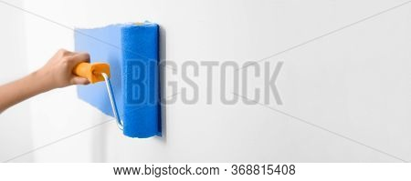 Professional Decorator Painting White Wall With Blue Dye, Space For Text. Banner Design