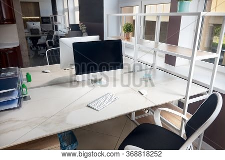 Grodno, Belarus - May 2020: Two Apple Imac In Office Table With Blank Displays With Stoneware Table