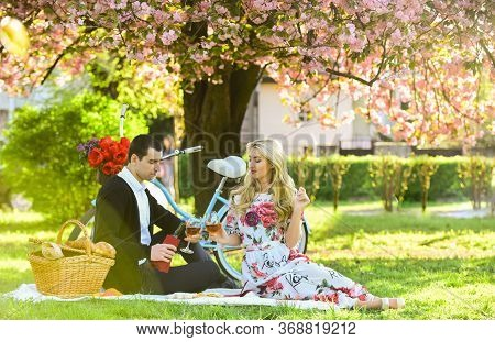 Couple In Love Picnic Date. Enjoying Their Perfect Date. Happy Loving Couple Relaxing In Park With F
