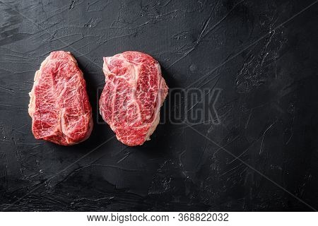 Raw Organic Meat Top Blade Steaks Or Australia Wagyu Oyster Blade On Black Background Top View Space