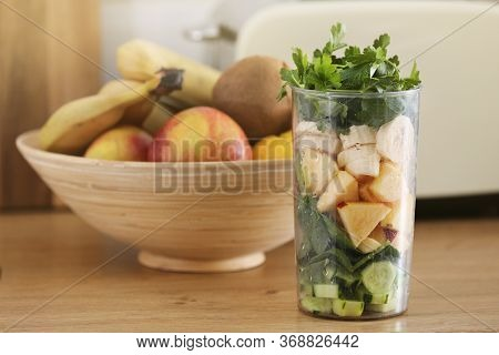 Cooking Healthy Detox Smoothie With Fresh Fruits And Green Spinach. Healthy Lifestyle Detox Concept.