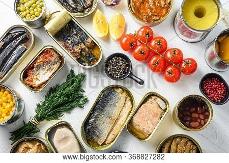 Different Canned Conserve Products In Tin Cans. With Fresh Organic Ingridients Saury, Mackerel, Spra