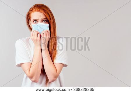 Redhair Ginger Woman Feeling Unhappy And Wearing Medical Mask