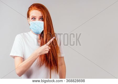 Redhaired Ginger Woman Pointing Finger At Copyspace Open Mouth