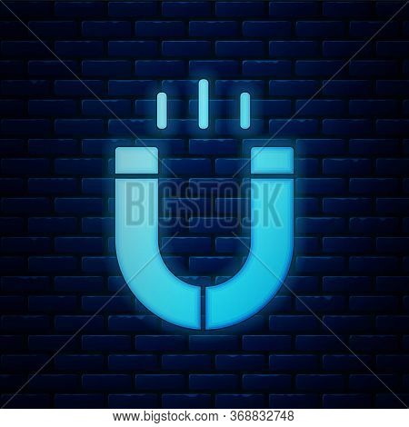 Glowing Neon Magnet Icon Isolated On Brick Wall Background. Horseshoe Magnet, Magnetism, Magnetize,