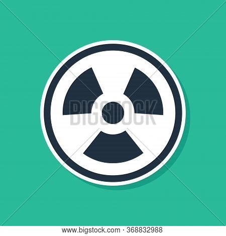 Blue Radioactive Icon Isolated On Green Background. Radioactive Toxic Symbol. Radiation Hazard Sign.