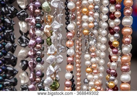 Various Colorful Beads In The Market. Wallpaper Background Of A Colorful Necklace Made Of Precious S