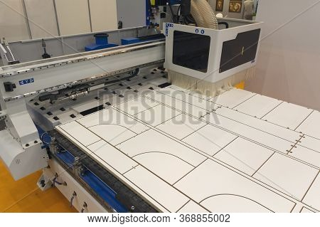 Machine Tools Format Cutting Are Cut Chipboard Furniture In The Shop. Industry