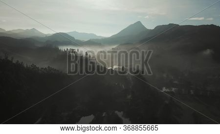 Aerial View Of The Dawn And The Mountains Near The City Of Munnar. Kerala. India.