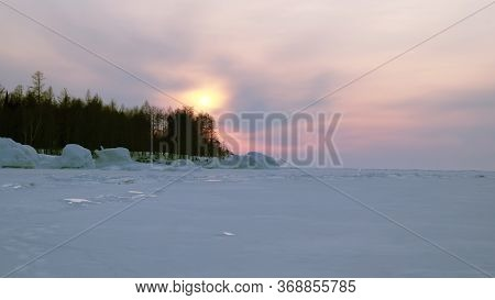 Landscape In Winter Sunset At Frozen Lake Baikal In Siberia
