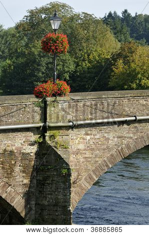 Floral display on Usk Bridge