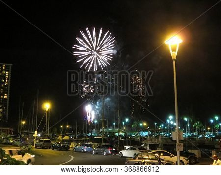 Honolulu - May 10, 2014: Friday Fireworks Burst In The Air As People Watch Display At Outdoor In Hon