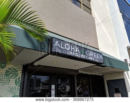 Honolulu - April 20, 2019: Aloha Green Apothecary Store, Which Is  Is A Licensed Medical Cannabis Di