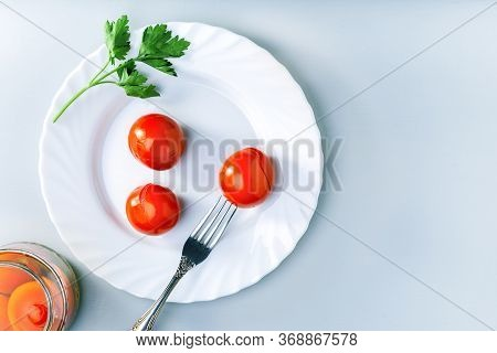 Juicy Spicy Marinated Tomatoes With Parsley On A White Plate. Top View With Copy Space.