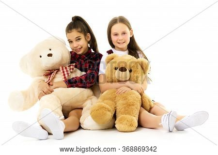 Little Girl With Toy. Two Beautiful Happy Girls Standing And Embracing Plushs Toy In Children Room.