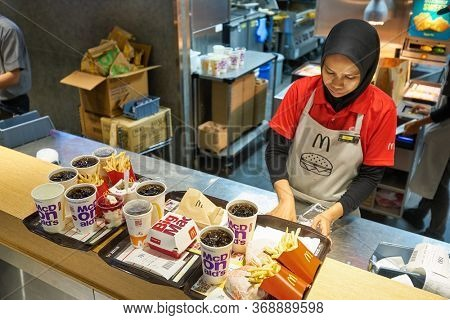 KUALA LUMPUR, MALAYSIA - CIRCA JANUARY, 2020: food served on trays at McDonald's restaurant in Kuala Lumpur.