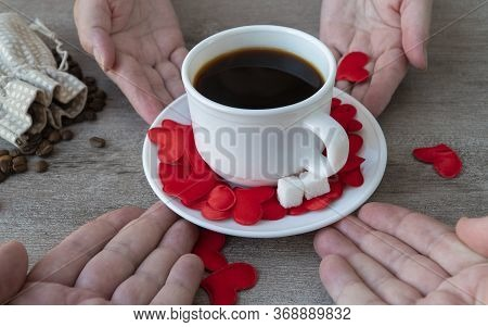 Cup Of Fragrant Coffee. Mug Is Passed From Hand To Hand. Romantic Theme, Making Coffee With Love.