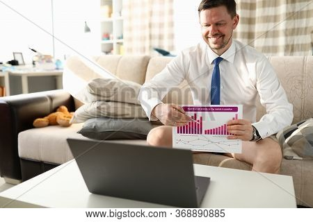 Manager Without Trousers Sits Home Video Conference. Manager Sits At Home In Front Laptop And Shows
