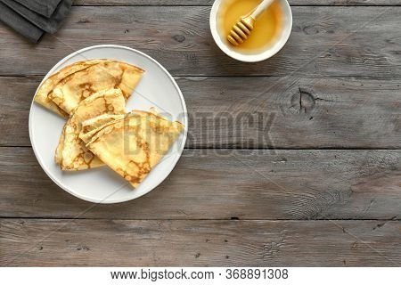 Crepes (blini) On Wooden Background, Top View, Copy Space. Homemade Recipe Of Thin Crepes For Breakf