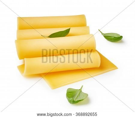 Cheese Slices Isolated On White Background. Pieces Of Cheese With Basil Leaves.