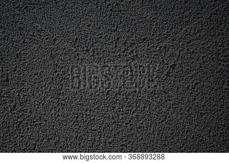 Background Image Of A Rough Painted Wall. Rough Surface Texture. Decorative Plaster. Monotonous Wall