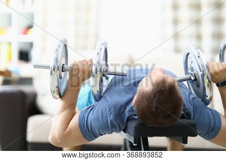 Man Doing Strength Exercises With Dumbbells Home. Availability Free Space In Apartment For Sports. Q