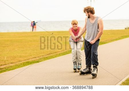 Active Holidays, Exercises, Relationship Concept. Young Man Dressed In Sports Clothes Putting His Gi