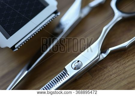 On Table Are Hairdressing Scissors And Trimmer. Buy Scissors For Beginner Hairdresser. Hot Scissors