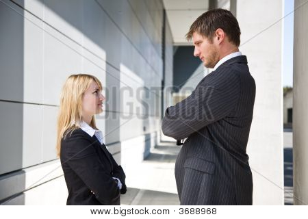 Two Angry Caucasian Business People