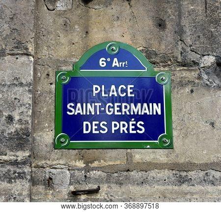 Place Saint-germain Des Pres Street Sign Close-up. Paris, France. Text: 6th District. Square Saint-g