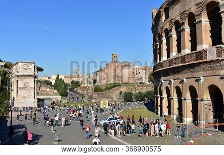 Rome, Italy. October 9, 2019. Colosseum, Roman Forum And Arch Of Constantine With Tourists And Blue