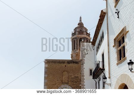 Low Angle View Of Facades Of House And Church Of San Bartolome And Santa Tecla With Clear Sky At Bac