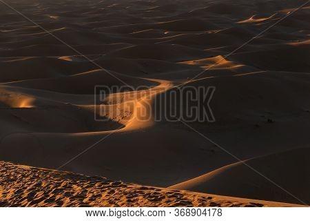 Sunset Over Erg Chegaga, Morocco. Erg Chegaga (or Chigaga) Is One Of Two Major Saharan Ergs In Moroc