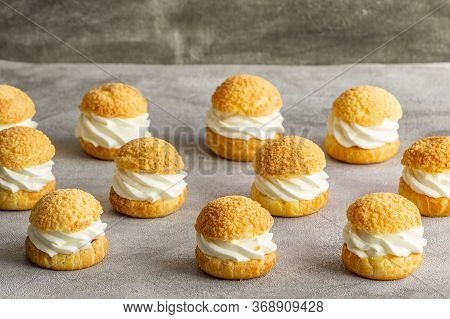 Chou Pastry Biscuits Fillechou Pastry Biscuits Filled With Whipped Cream On Grey Background. Concept
