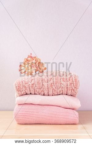 Stack Of Knitted Women's Clothing, Warm Sweaters, Jacket, Blouse In Pastel Colors. Stack Of Winter O