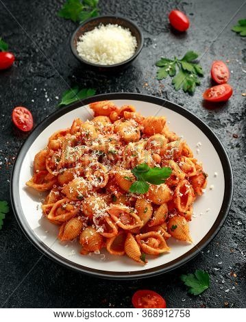 Conchiglie Rigate Pasta With Chickpeas In Tomato Sauce With Parmesan Cheese. Healthy Vegan Food.