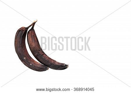 Two Rotten Blackened And Dried Bananas Are Isolated On A White Background. Spoiled Food.