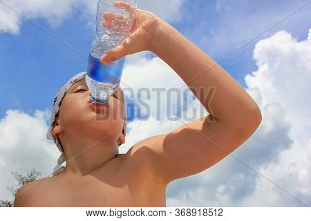 Thirsty Child Drinking Fresh Cool Water From Bottle In Hot Summer Day On Tropical Beach. Cute Caucas