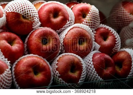 Close Up View Of Fruits Shelf In Supermarket. Apple Background