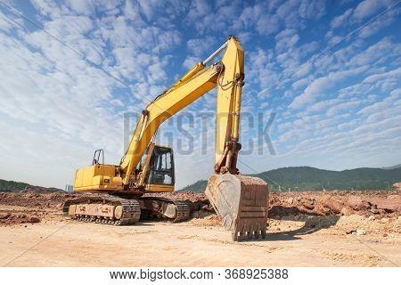 huge heavy shovel excavator digger on gravel construction site