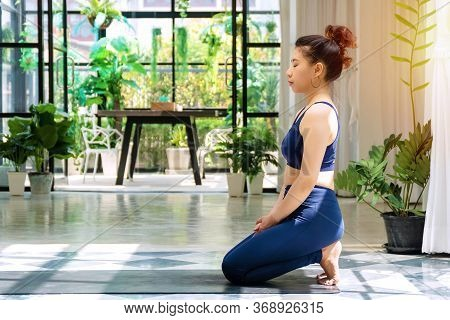 Activity Young Women Wear Blue Sportswear Doing Position Detox Yoga Sequence On The Mat. Relaxation