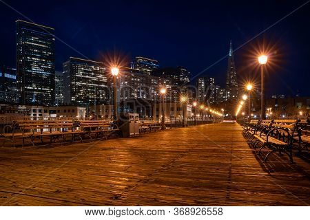 San Francisco downtown cityscape skylines ans skyscrapers building from pier at night in California, USA. San Francisco United States Landmark Travel Destination cityscape urban and tourism concept.