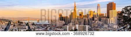 Panoramic Sunset at San Francisco downtown cityscape skylines ans skyscrapers building in California, USA. San Francisco United States Landmark Travel Destination cityscape urban and tourism concept.